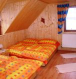 Wooden cabin Liptovské Revúce 944 - apartment A: 2 x double-bed (2 x  single bed), 2 x four-bedded room (4 x  single bed), common room (TV+SAT, CD player, DVD player, radio alarm clock, prepojená s kuchyňou), kitchen (fridge with freezer, electric kettle, cooker, electric oven for baking, microwave oven), 2 x bathroom (shower cabin, WC in the bathroom), separate entrance
