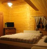 Wooden cabin Oščadnica 3817 - double-bed + 1 x additional bed:   (1 x fold-out couch), TV, wi-fi (wireless) connection, Internet for free, towels, sofa set, seating, parking place, Own bathroom in room (shower cabin, washbasin, WC in the bathroom), attic